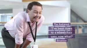 "A person bending down with a cheesy smile, with text reading ""The Awkward 'I've bent down to a wheelchair user, now what?' Situation."" Source: SCOPE"