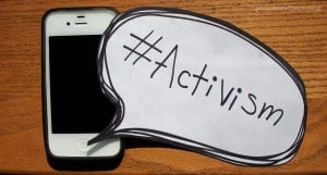 "iPhone with a speech bubble, reading ""#Activism"""