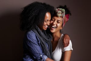 Two people hugging, happily