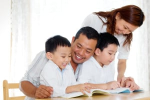 Family reading together happily
