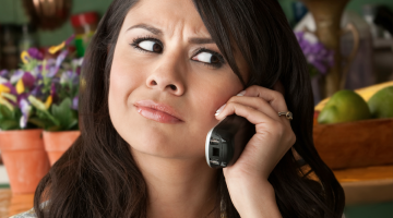 Person annoyed while talking on the phone, presumably at what the person on the other end is saying
