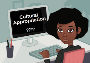 """A person sits at a computer. The screen says """"Cultural Appropriation????"""""""