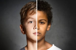 Two children of different races are shown together