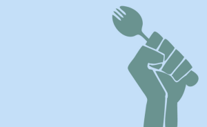 The Black power symbol of a fist, holding a fork