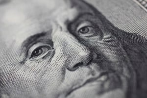 A close-up of Benjamin Franklin's face on a 100-dollar bill