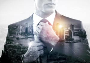 A business person putting on a tie, overlapping with a sprawling city